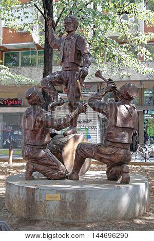 SKOPJE MACEDONIA - SEPTEMBER 17: Sculpture Teshkoto in Skopje on SEPTEMBER 17 2012. Bronze Monument Teshkoto Portrays Traditional Folk Dance in Skopje Macedonia.