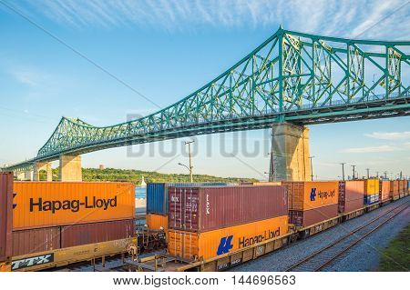 Montreal CA - 27 August 2016: Trains under Jacques-Cartier Bridge in Montreal at sunset