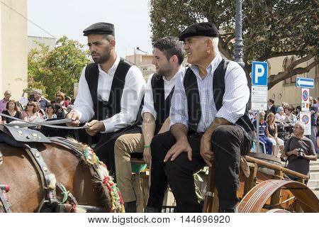 QUARTU S.E., ITALY - September 15, 2013: Wine Festival in honor of the celebration of St. Helena - Sardinia - group of people in Sardinian costumes