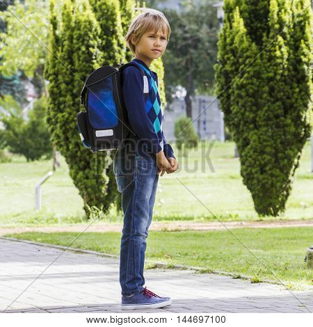 Pupil with a backpack ready go to school. Outdoor. Education back to school people concept. Square format image