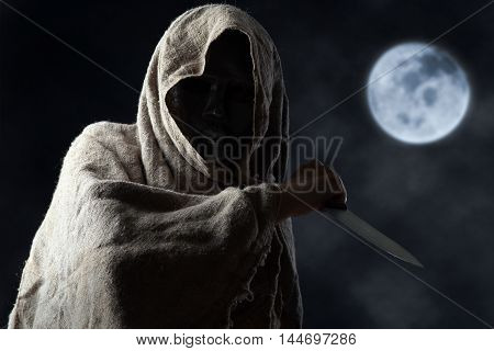 Hooded Man In Mask With Knife