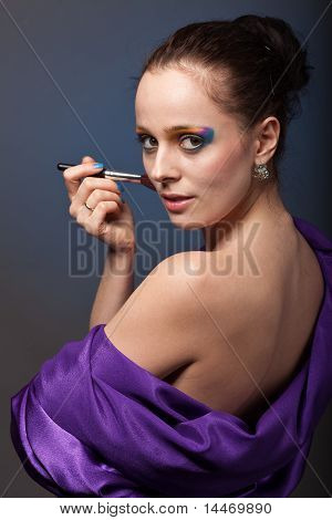 Young Woman With Brush For Make-up.