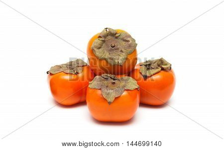 ripe persimmon isolated on white background close-up. horizontal photo.