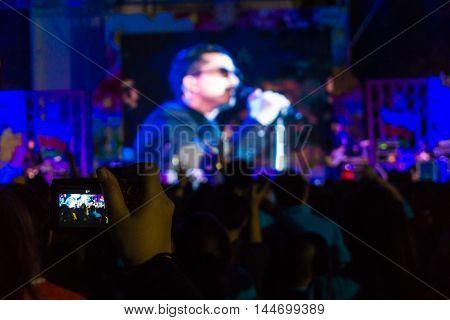 Defocused Blurred Concert People Crowd Background.