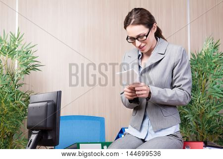 Office woman making paper airplanes