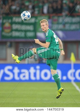 VIENNA, AUSTRIA - AUGUST 19, 2015: Florian Kainz (SK Rapid) kicks the ball in an UEFA Champions League qualification game.