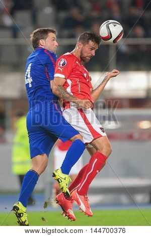 VIENNA, AUSTRIA - SEPTEMBER 5, 2015: Iulian Erhan (Moldavia) and Martin Harnik (Austria) fight for the ball in an European Championship qualification game.