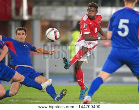 VIENNA, AUSTRIA - SEPTEMBER 5, 2015: Igor Armas (Moldavia) and David Alaba (Austria) fight for the ball in an European Championship qualification game.