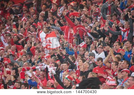 STOCKHOLM, SWEDEN - SEPTEMBER 8, 2015: Austrian fans celebrate the victory after an European Championship qualification game.