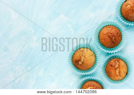 Fresh homemade muffins on a blue background