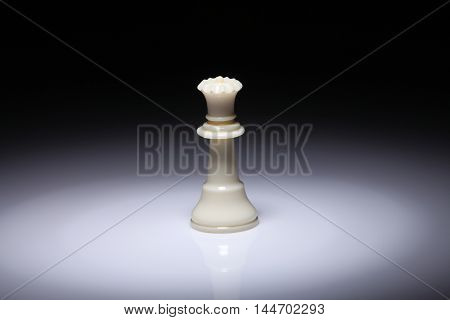 chess piece queen on the white background with spot light