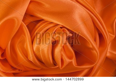Texture of the satin fabric with many folds