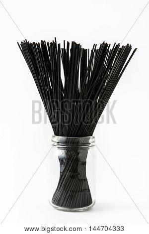 Delicious black spaghetti isolated on white background
