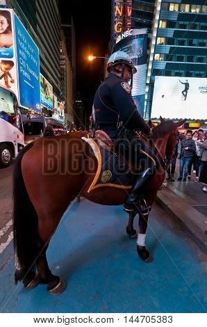 New York USA - November 20 2011: Mounted NYPD Policemen on horses on duty at night near Times Square Manhattan New York USA.