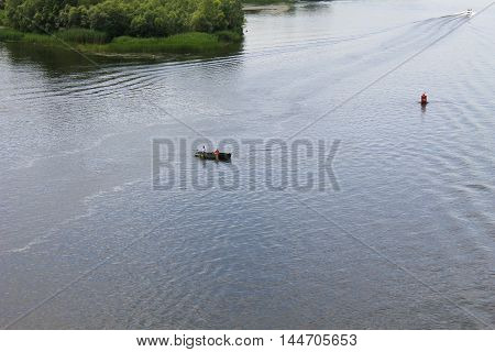 Boat with fishermen at the river Dnieper Ukraine