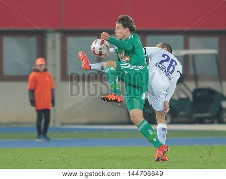 VIENNA, AUSTRIA - OCTOBER 28, 2015: Stefan Schwab (SCR) and Leonard Kaufmann (SBG) fight for the ball in an Austrian Football Cup game.
