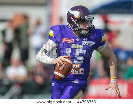 VIENNA, AUSTRIA - APRIL 3, 2016: Alexander Thury (Vienna Vikings) runs with the ball in a game of the Austrian Football League.