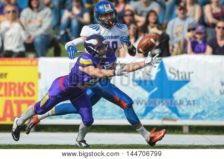 VIENNA, AUSTRIA - APRIL 3, 2016: Andreas Lunzer (Vienna Vikings) and Eugen Sumic (Ljubljana Silverhawks) fight for the ball in a game of the Austrian Football League.