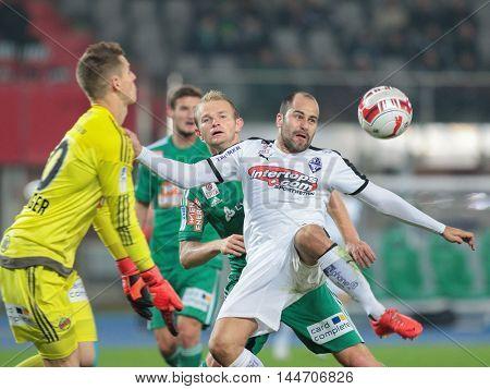 VIENNA, AUSTRIA - OCTOBER 28, 2015: Mario Sonnleitner (SCR) and Leonard Kaufmann (SBG) fight for the ball in an Austrian Football Cup game.