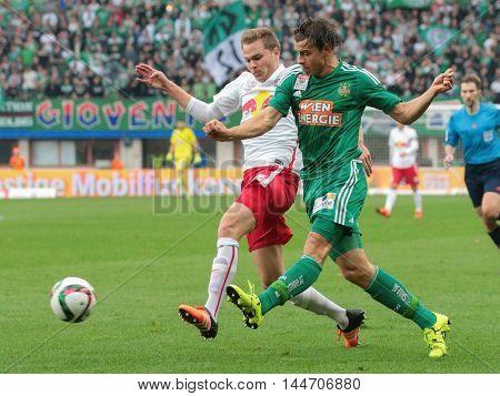 VIENNA, AUSTRIA - OCTOBER 4, 2015: Benno Schmitz (RB Salzburg) and Stefan Schwab (SK Rapid) fight for the ball in an Austrian Football League game.