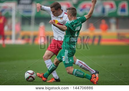 VIENNA, AUSTRIA - OCTOBER 4, 2015: Benno Schmitz (RB Salzburg) and Philipp Schobesberger (SK Rapid) fight for the ball in an Austrian Football League game.