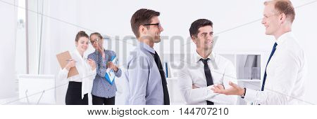 Men Engulfed In Discussion