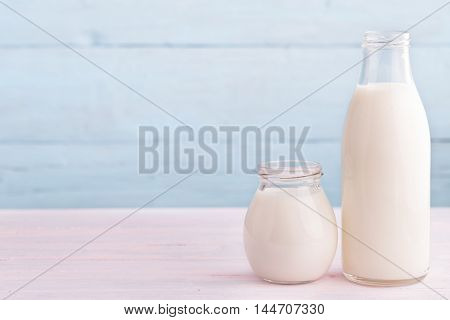 Milk and yogurt from right side light blue background