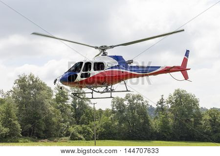 aviation: helicopter photographed during the takeoff phase