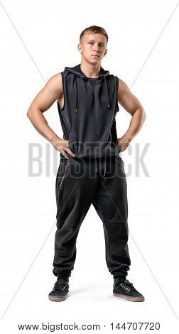 Full lenght portrait of muscled young man with his hands on hips, isolated on white background. Workout, fitness, sport. Healthy lifestyle. Strength.