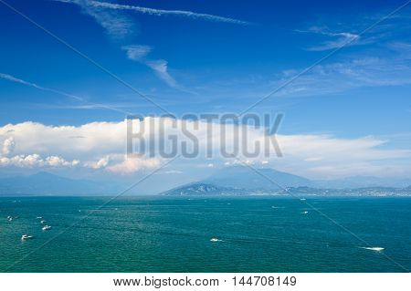 High mountains on other coast of Garda lake, Desenzano, italy