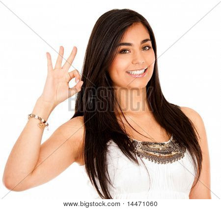 Woman making an ok sign with her hand - isolated