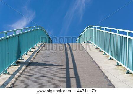 Pedestrian bridge steel arch structure over the river Ruhr in Muelheim Germany.