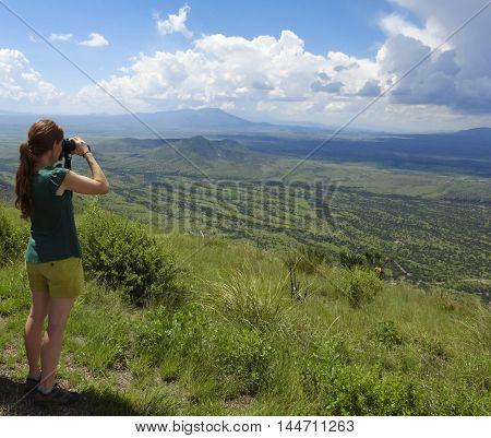 SIERRA VISTA, ARIZONA, AUGUST 21. Coronado Peak on August 21, 2016, near Sierra Vista, Arizona. A woman gazes into Mexico on top of Coronado Peak in the Huachuca Mountains near Sierra Vista Arizona.