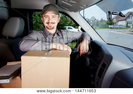 Young delivery man with a parcel.