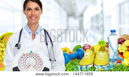 Doctor woman with scales.