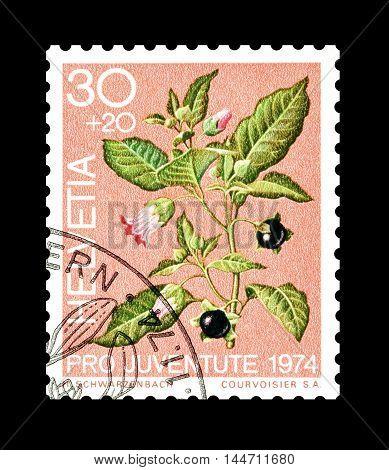 SWITZERLAND - CIRCA 1974 : Cancelled postage stamp printed by Switzerland, that shows Belladonna.