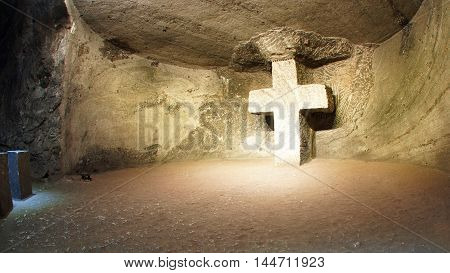Zipaquira, Cundinamarca / Colombia - January 19 2016: Cross carved on a stone wall in a living stone in The Salt Cathedral of Zipaquira