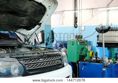 Russia, Moscow - August, 26, 2016: Car with open hood in a repair station in Moscow, Russia