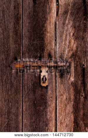 Dusty Bolt On Grungy Old Wooden Door.