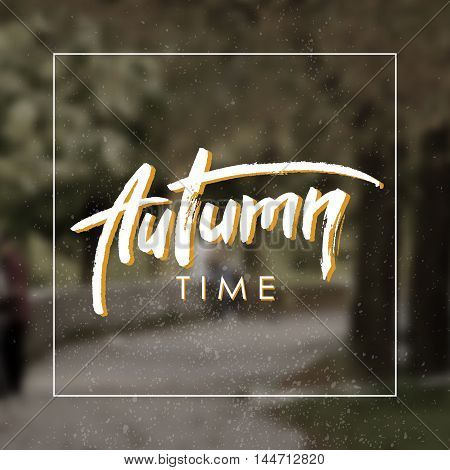 Autumn time. Handwritten autumn greeting card. Monochrome blurred background.