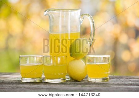 lemon juice on a wooden table, autumn set, outdoor