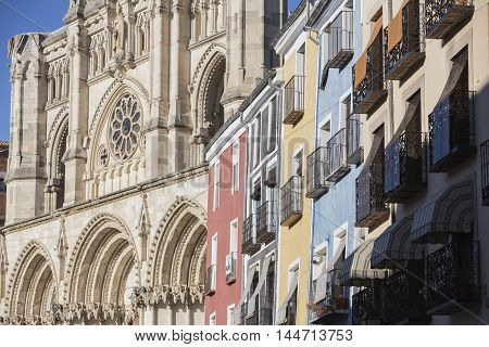 CUENCA SPAIN - August 24 2016: Detail of the colourful buildings and Cathedral on Plaza Mayor Cuenca Castilla La Mancha Spain