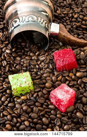 Turkish coffee pot and turkish delights on coffee beans