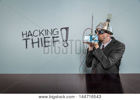 Hacking thief text with vintage businessman kissing machine