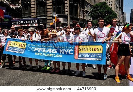 New York City - June 29 2014: PFLAG marchers with their banner at the 2014 Gay Pride Parade on Fifth Avenue