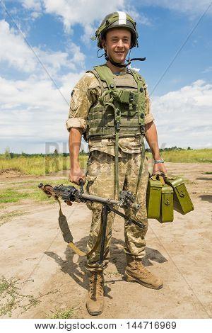 Lviv Ukraine - July 6 2016: Ukrainian-American joint military exercises near the Lviv rapid trident 2016. Ukraine machine gunner ready to take a firing position Lviv.Ukraine.