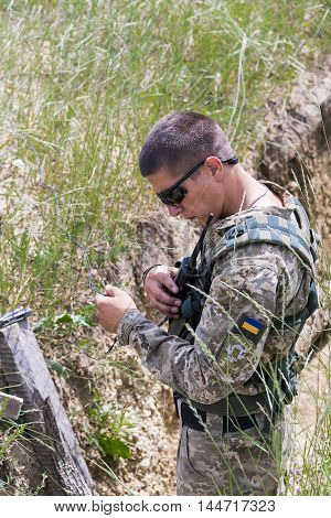 Lviv Ukraine - July 6 2016: Ukrainian-American joint military exercises near the Lviv rapid trident 2016. Ukrainian sapper sets pyrotechnic charge Lviv.Ukraine.