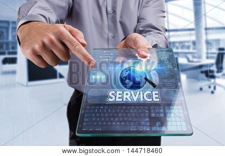 Business, Technology, Internet And Network Concept. Young Business Man Working On The Tablet Of The