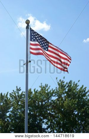 The American flag is flown proudly on a pole.