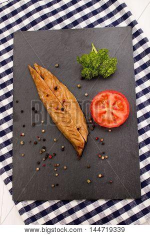 fresh smoked scottish mackerel with tomato parsley peppercorn on slate